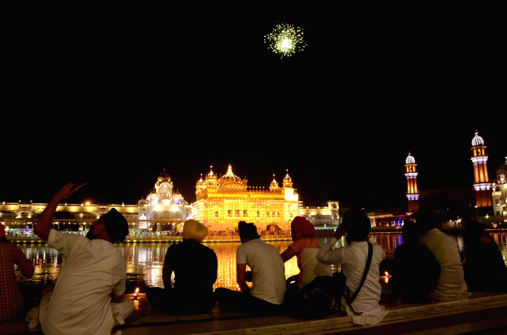 Fireworks at  Golden temple on the occasion of the birth anniversary of Guru Amar Das (Third Guru of Sikhism) in Amritsar, Tuesday, May 25, 2021.
