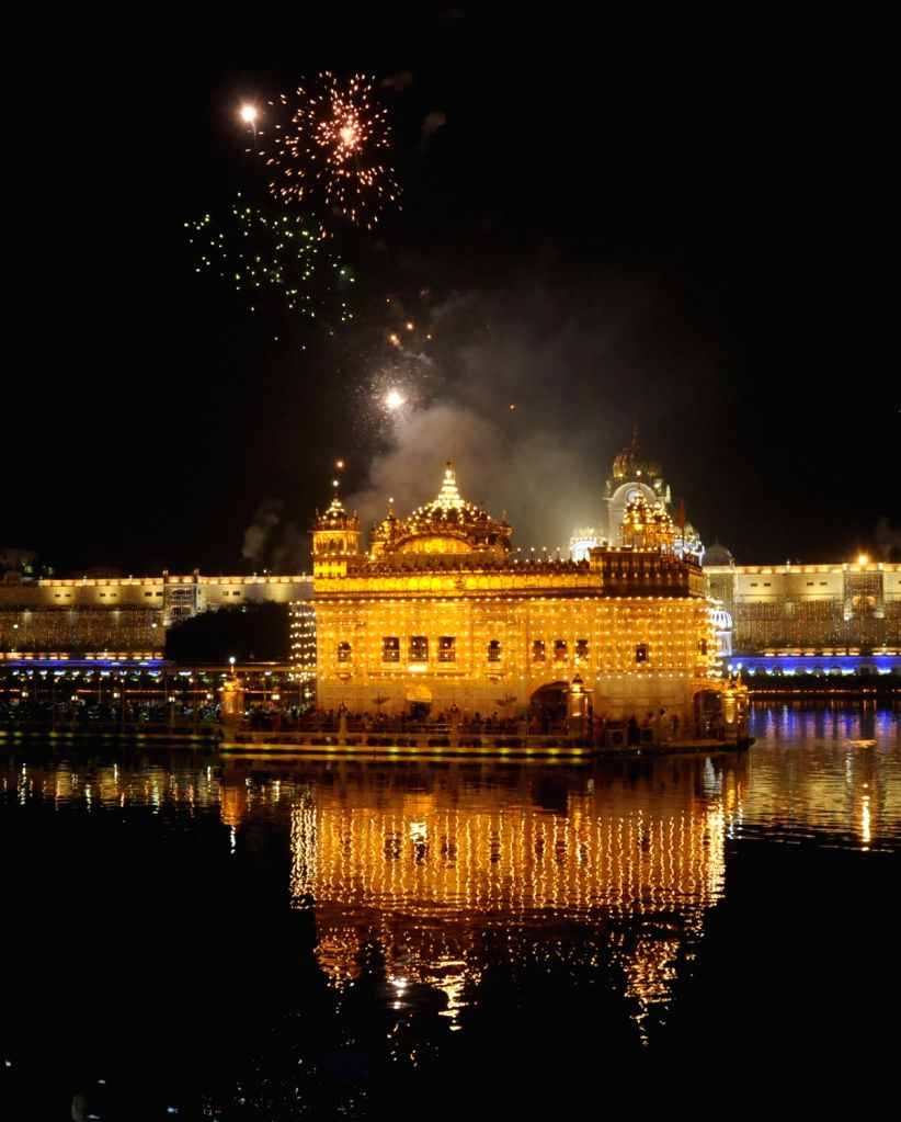 Fireworks at the Golden Temple that has been illuminated on the occasion of 550th birth anniversary of Guru Nanak Dev, in Amritsar on Nov 12, 2019. - Nanak Dev