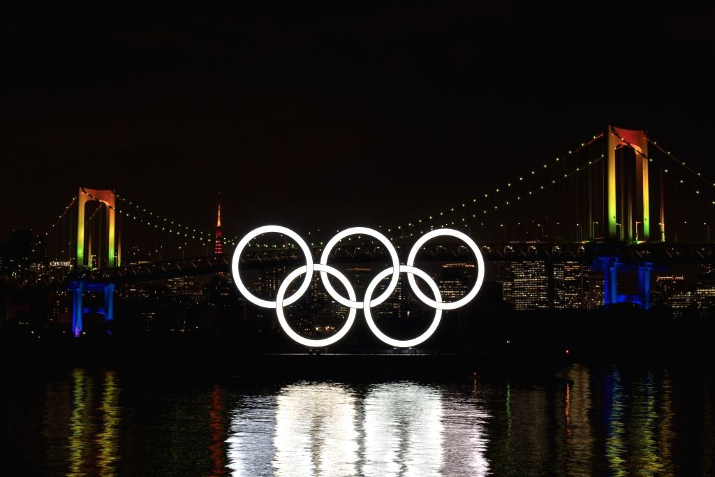 Fireworks explode over the illuminated Olympic rings during an event to mark six months before the opening of the Tokyo 2020 Olympic Games in Tokyo, Japan, on Jan. ...