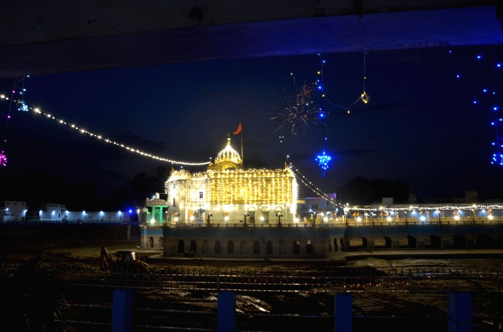 Fireworks light up the night skies over the Shri Durgiana Temple, also known as Lakshmi Narayan Temple as celebrations break out on the day when Prime Minister Narendra Modi performed the ... - Narendra Modi