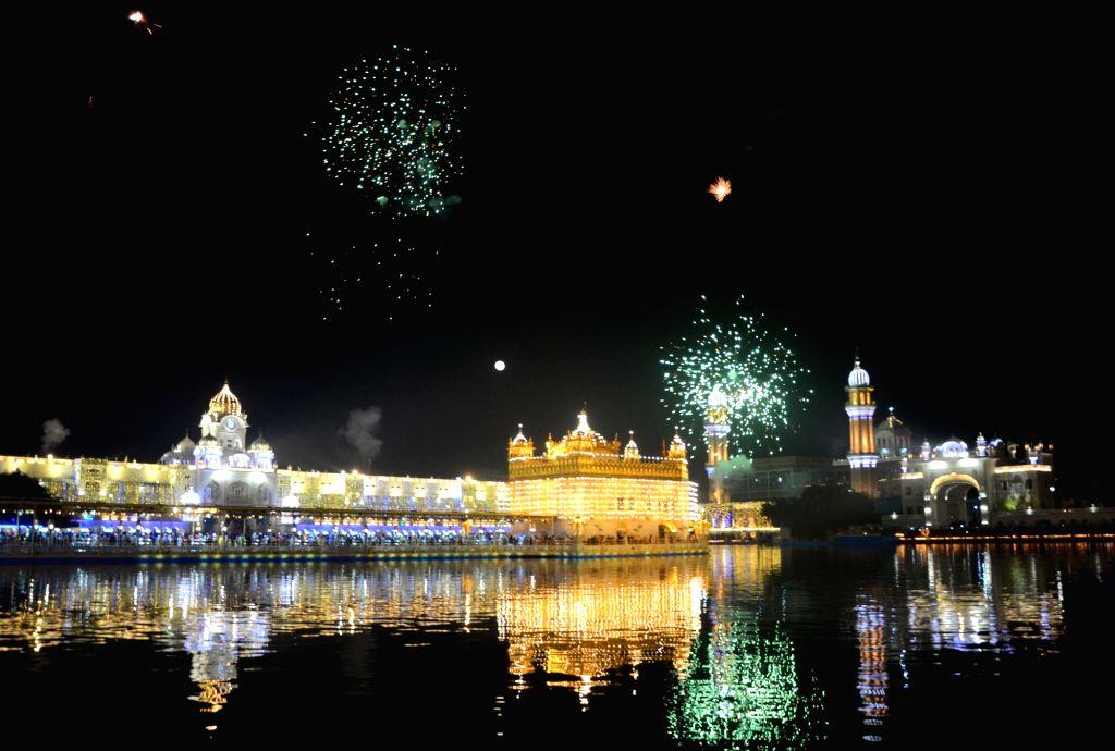 Fireworks light up the skies over the illuminated Golden Temple on Guru Nanak Jayanti, in Amritsar on Nov 30, 2020.