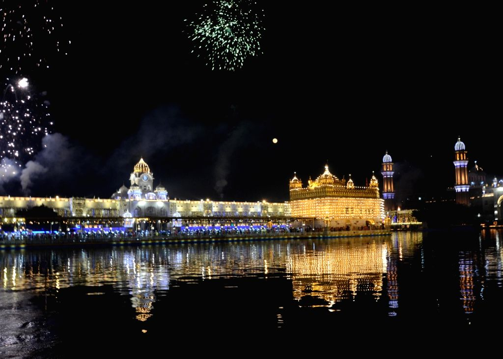 Fireworks light up the skies over the illuminated Golden Temple on Guru Nanak Jayanti, in Amritsar on Nov 30, 2020.