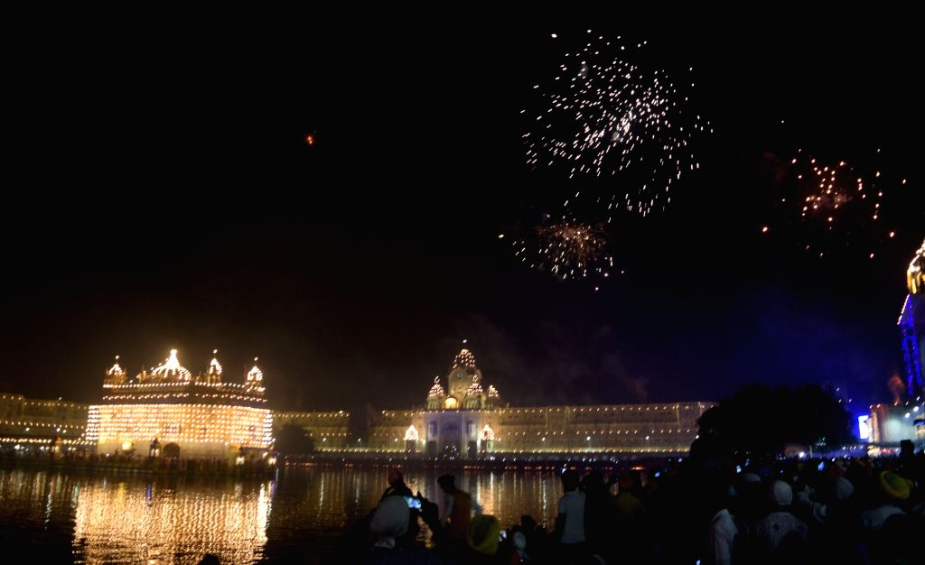 Fireworks light up the sky above the Golden Temple on Diwali in Amritsar on Oct 30, 2016.