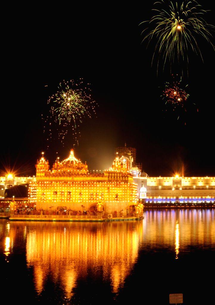 "Fireworks light-up the sky above the Golden Temple on ""Parkash Purab of Sri Guru Granth Sahib"" at the Golden Temple in Amritsar on Sept 10, 2018."