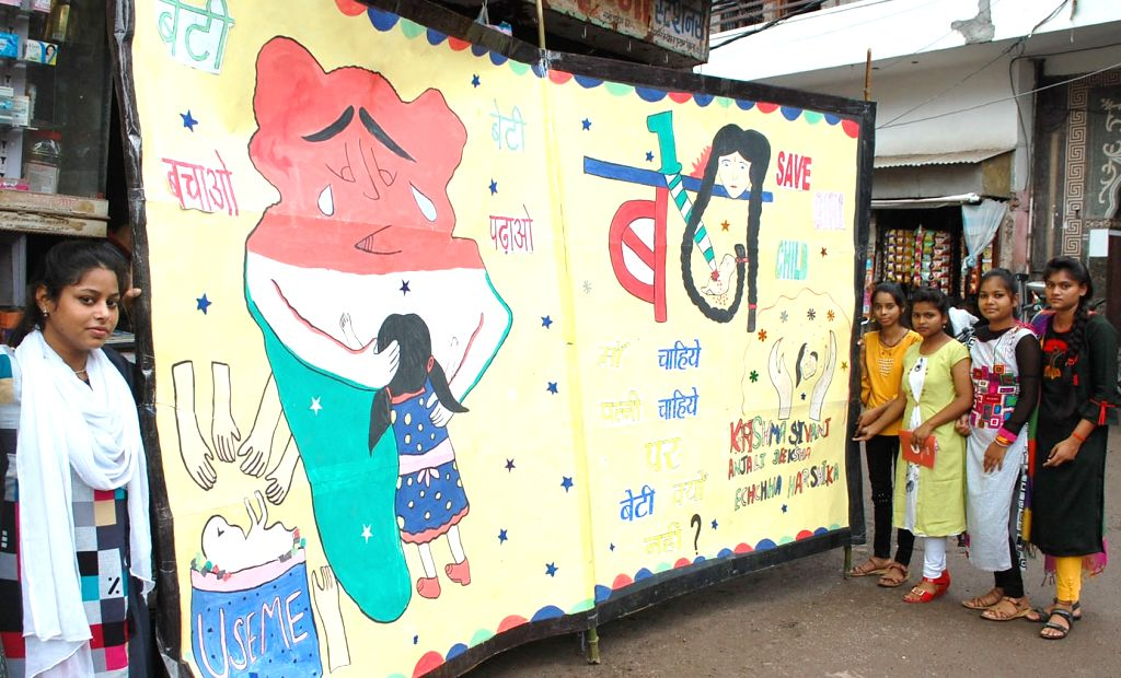 Firozabad: Sixty students have created a unique 1,000-feet-long greeting card, with socially relevant messages, to greet the 'Father of the Nation' on his birthday, in Uttar Pradesh's Firozabad on Sep 28, 2019. (Photo: IANS)
