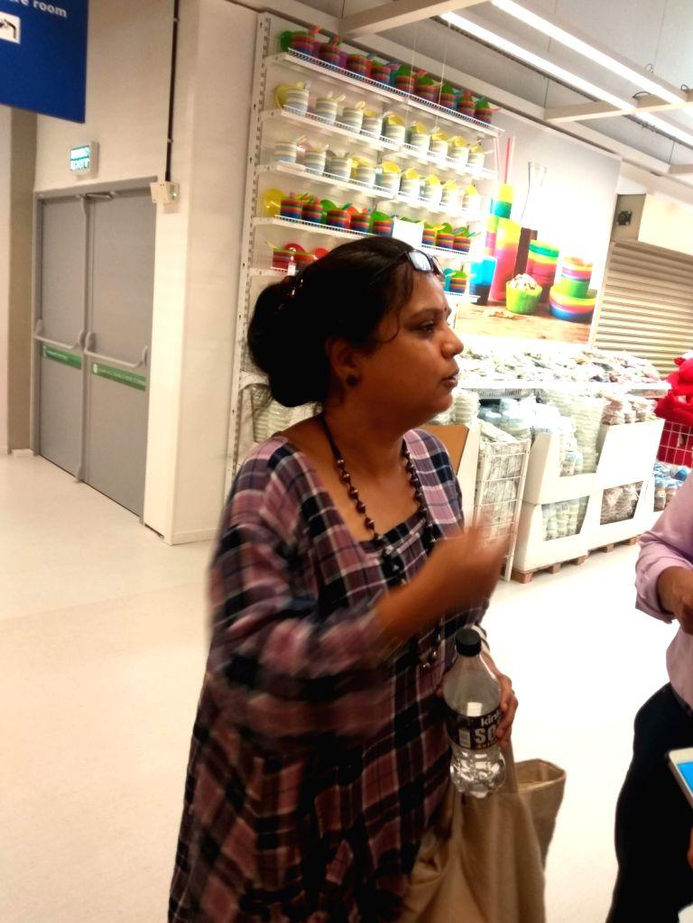 First customer Rajni Venugopal shopping at store.