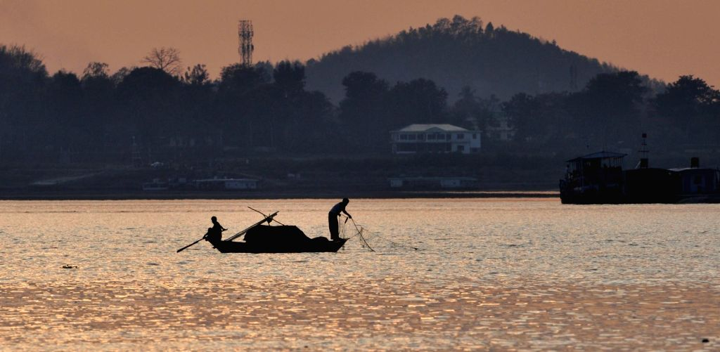 Fishermen busy fishing in Brahmaputra river in Guwahati on March 2, 2019.