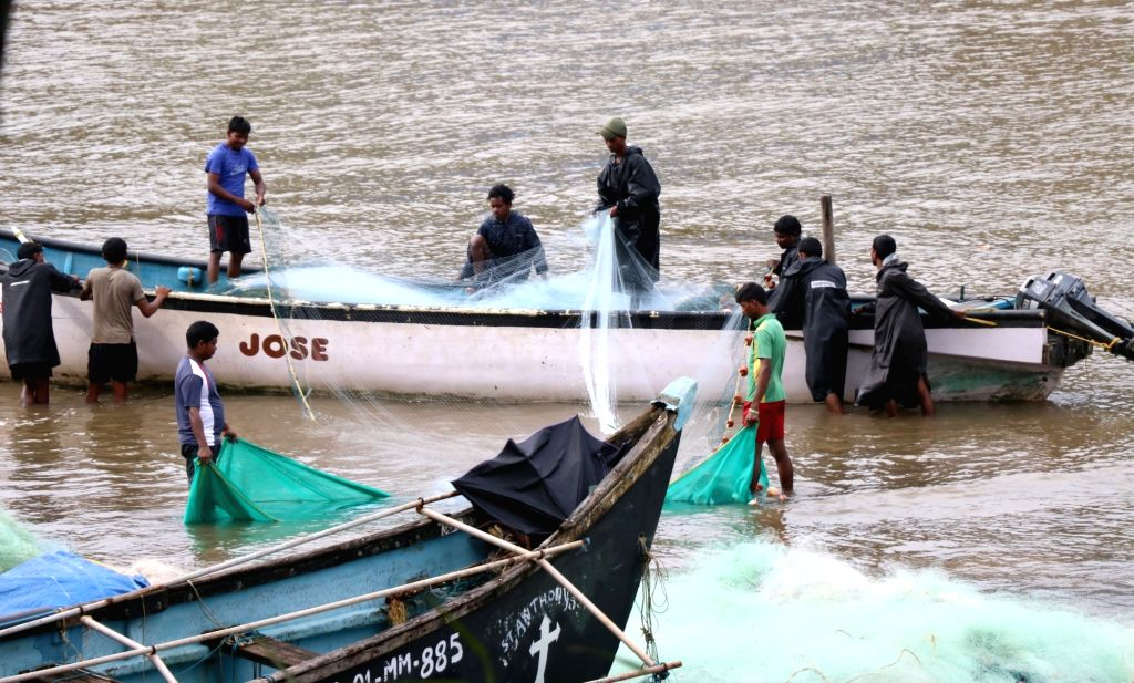 Fishermen busy loading fishing net on their trawler ahead of the start of the fishing season from August 1 after the end of 61-day fishing ban in Goa; at Nerul on July 27, 2019.