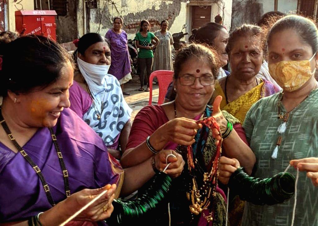 Fishermen community peoples cultural traditional tree on wearing Devi Holika wearing ornaments, mask etc preparation to celebrate Holi festival at Mahim Fishermen Colony in Mumbai yesterday ...