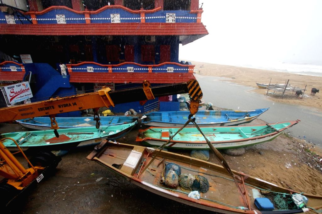 Fishermen engaged in getting their boats anchored and other preventive measures ahead of the impending Cyclone Nivar that is going to cross into Tamil Nadu, at Mahabalipuram on Nov 24, ...