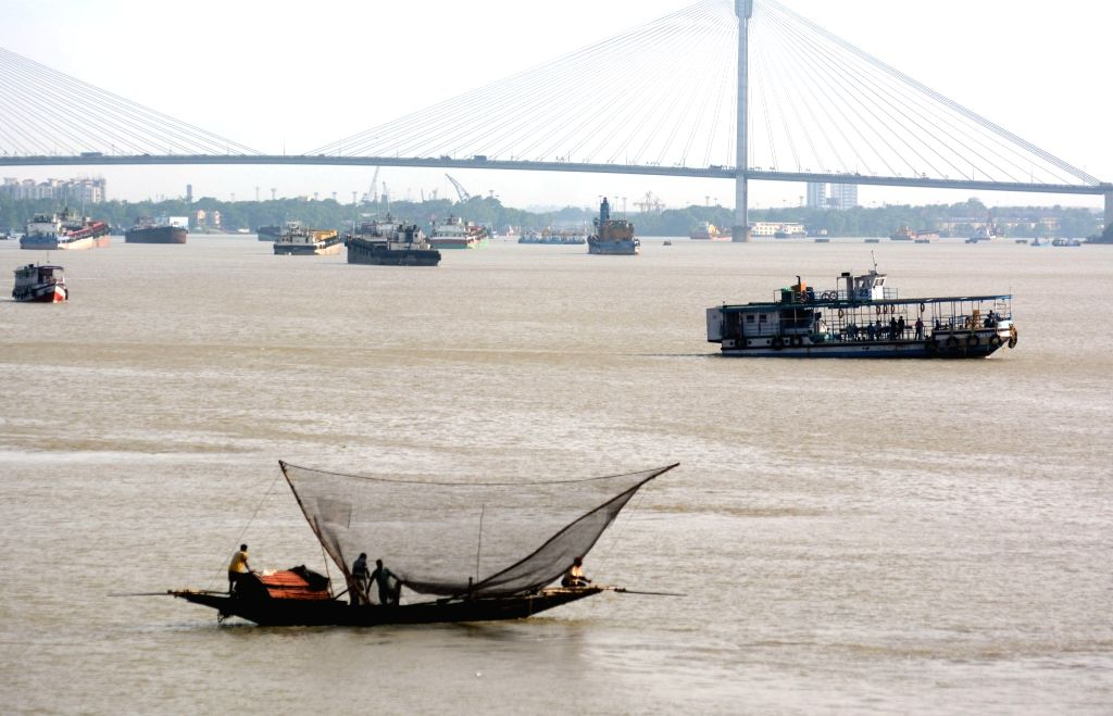 Fishermen go fishing on their boats at the Ganga river during nationwide lockdown 5 imposed in the wake of COVID 19 Coronavirus pandemic in Kolkata on June 26, 2020.