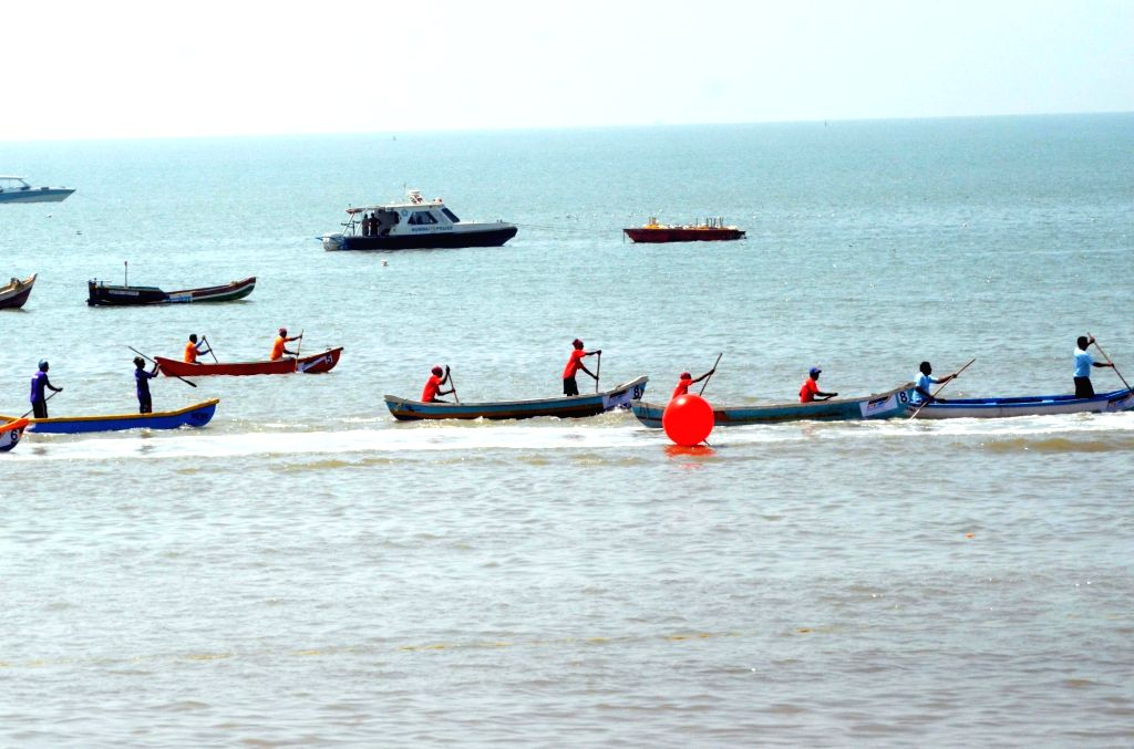 Fishermen participate during Fisherman cultural boat competition organised by P1 Powerboat Indian Grand Prix in Mumbai on March 4, 2017.