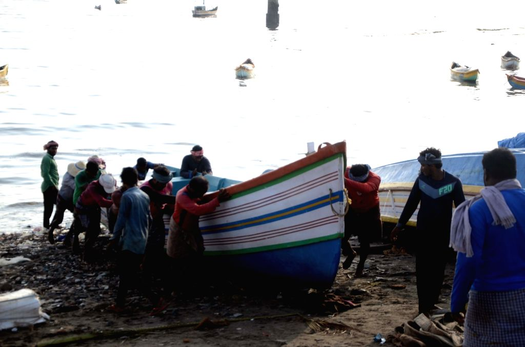 Fishermen take their boats off sea as 61-day fishing ban comes into force from today, in Mumbai on June 1, 2019.