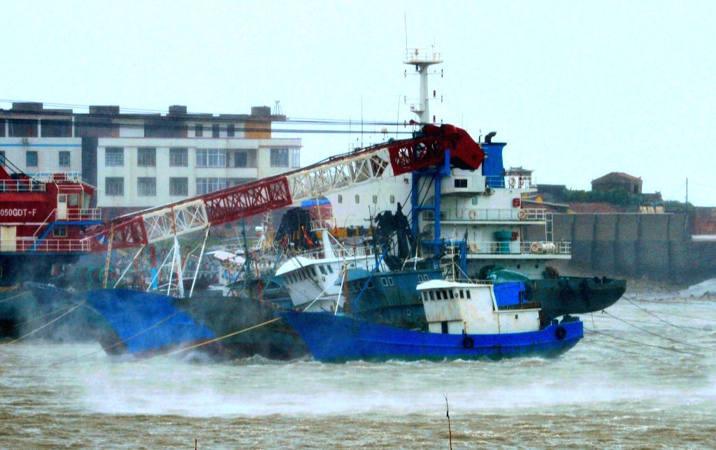 Fishing boats are seen at a wharf in Putian City, southeast China's Fujian Province, Aug. 8, 2015. Fujian Province on Saturday issued its highest typhoon alert as ...