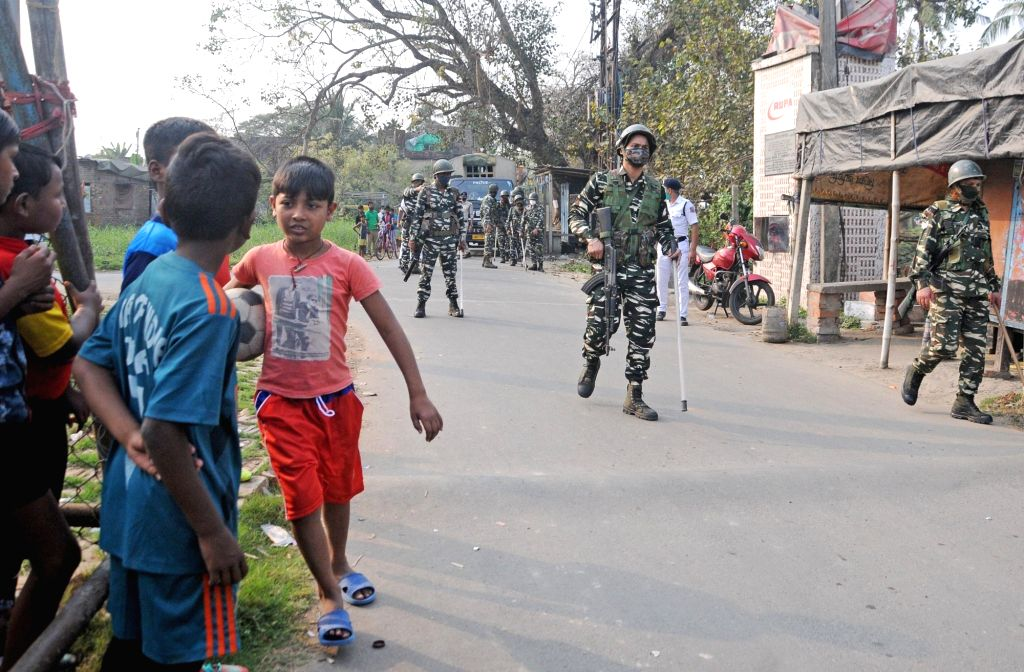 Flag march by Paramilitary forces at Salt Lake, Sector 4 ahead of the upcoming West Bengal's Legislative Assembly elections in Kolkata on Feb 21, 2021 .