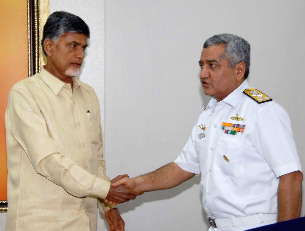 Flag Officer Commanding-in-Chief Eastern Naval Command Vice Admiral Satish Soni calls on Andhra Pradesh Chief Minister N. Chandrababu Naidu in Hyderabad on July 21, 2014. - N. Chandrababu Naidu