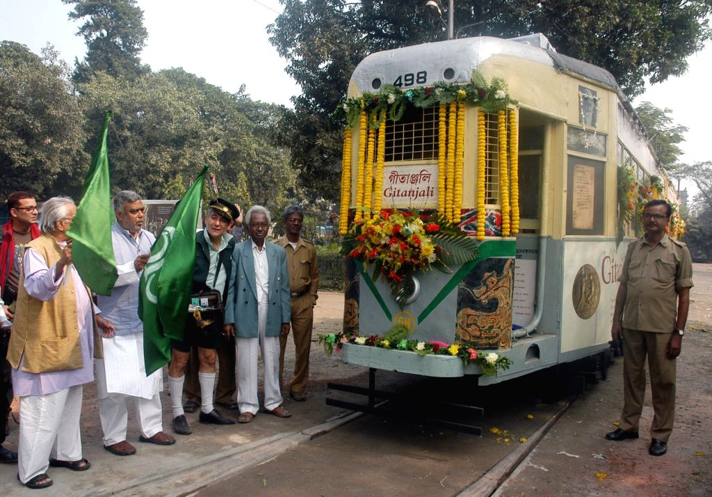 Flagging-off of Calcutta Tramways Corporation's Gitanjali tram which is a tribute to famous poet Rabindranath Tagore, in Kolkata on Dec.11, 2013.