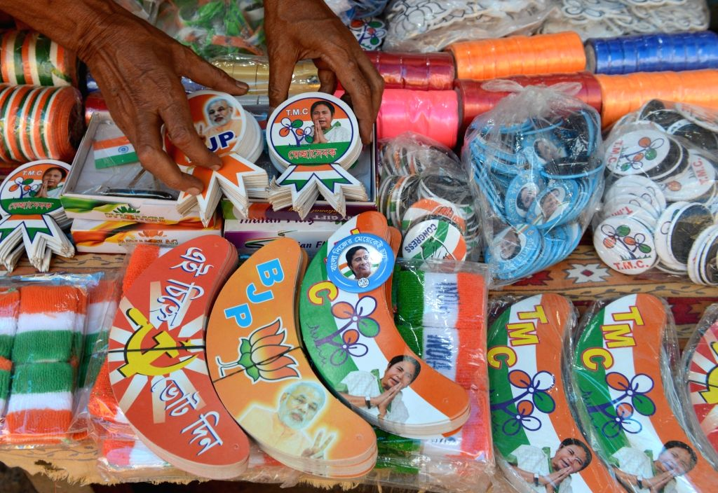 Flags, T-shirts and other things are being displayed to sell at a shop of various political parties, ahead of West Bengal's Assembly Elections in Kolkata on Saturday 06th March, 2021.