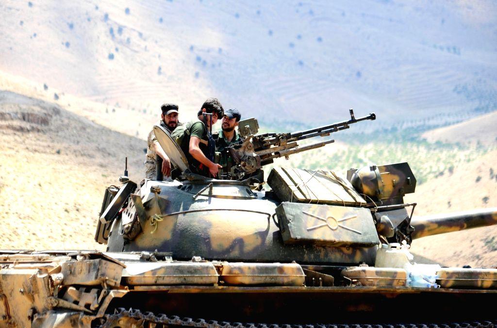 FLEITA, Aug. 3, 2017 - A Syrian tank is seen in the Syrian barren region of Fleita in western Syria near Lebanon as preparations were underway to transfer al-Qaida-linked Nusra Front militants on ...