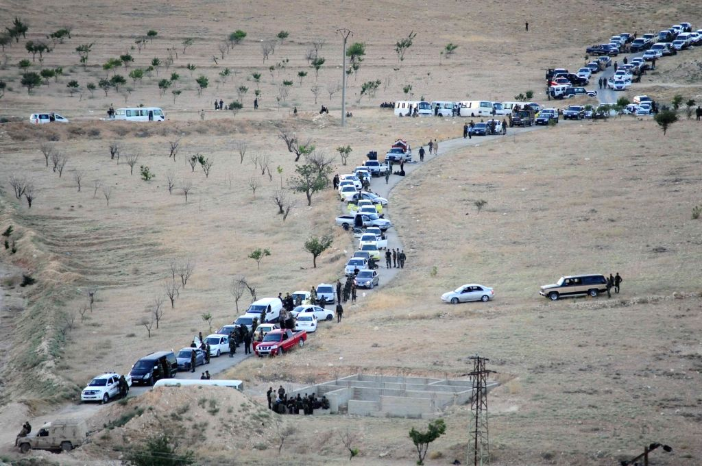 FLEITA, Aug. 3, 2017 - Convoy transporting rebels enter the Syrian barren region of Fleita in western Syria near Lebanon on Aug. 2, 2017. The first buses transporting militants with the ...