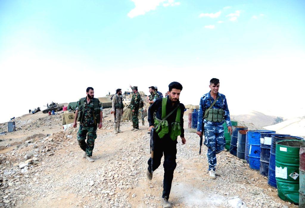 FLEITA, Aug. 3, 2017 - Syrian soldiers are seen in the Syrian barren region of Fleita in western Syria near Lebanon as preparations were underway to transfer al-Qaida-linked Nusra Front militants on ...
