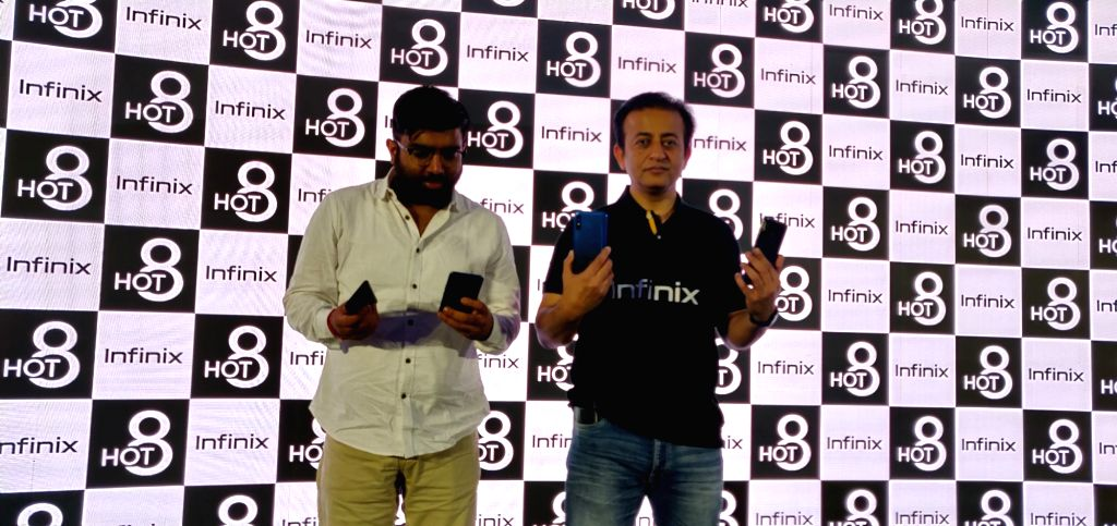 Flipkart Director Aditya Soni and Infinix India CEO Anish Kapoor unveil Infinix Hot 8 smartphone, in New Delhi on Sep 4, 2019. - Anish Kapoor