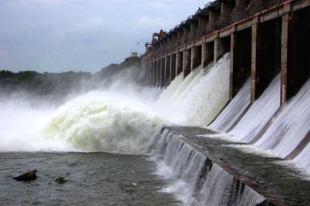 Flood gates are open of Maniar Dam in Kareem Nager District on August 17, 2013. (Photo::: IANS)