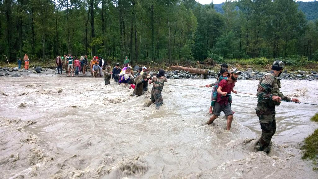 Flood victims being rescued by the Army personnel during the'Mission Sahayata', in Jammu & Kashmir.
