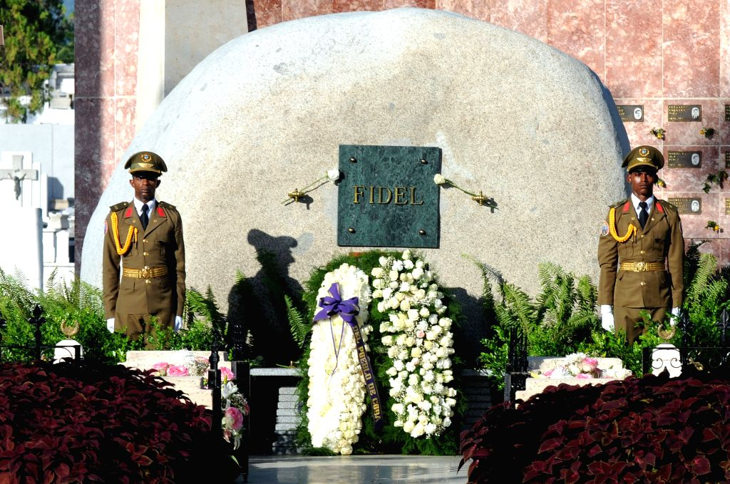 Floral offerings are seen in front of the tomb of late Cuban President Fidel Castro at the Santa Ifigenia Cemetery in Santiago de Cuba, east Cuba, Dec. 4, ...