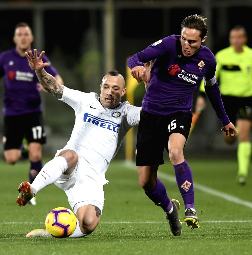 FLORENCE, Feb. 25, 2019 - Inter Milan's Radja Nainggolan (L) vies with Fiorentina's Federico Chiesa during a Serie A soccer match between Fiorentina and Inter Milan in Florence, Italy, Feb. 24, 2019. ...