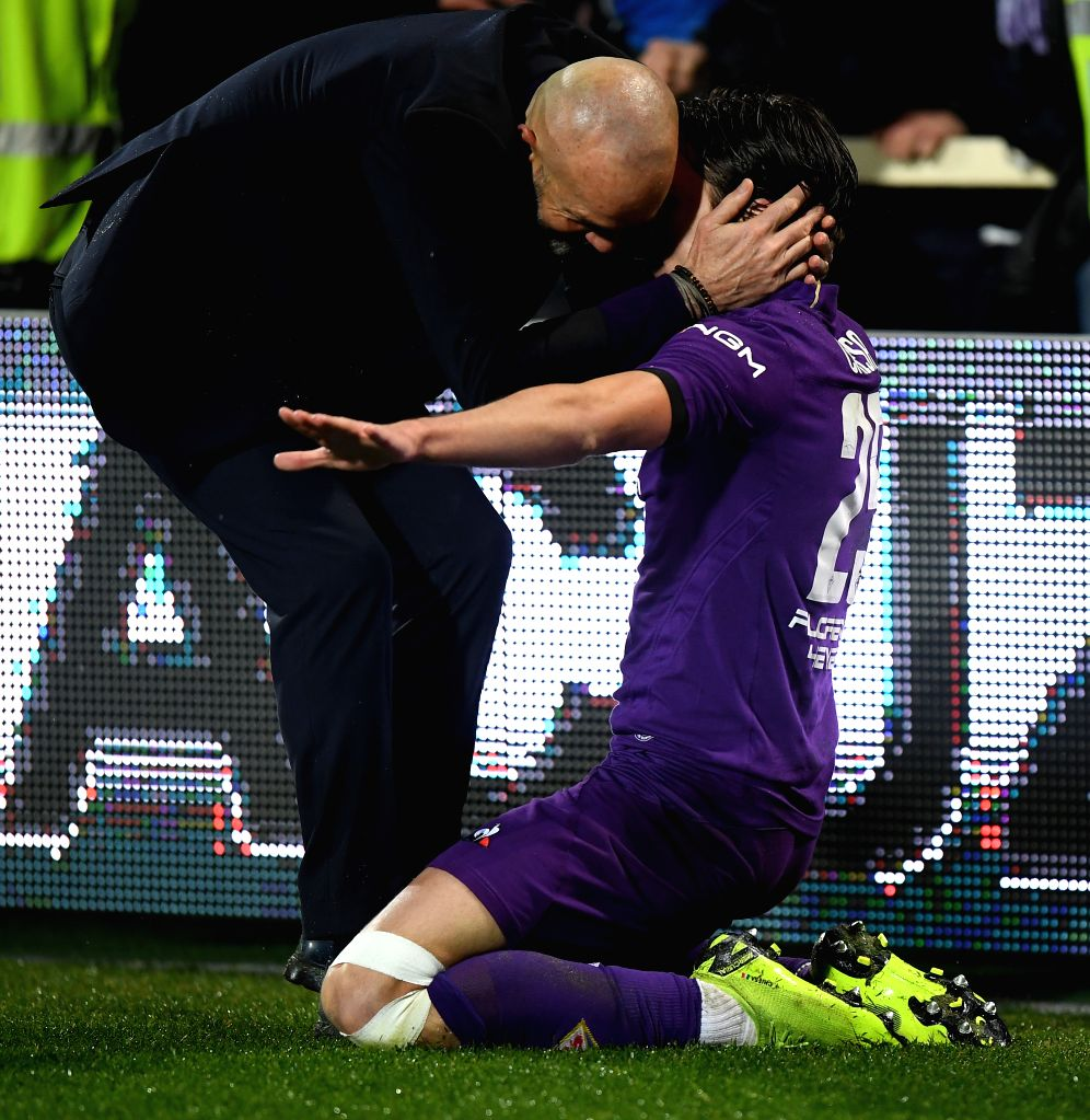 FLORENCE, Jan. 31, 2019 - Fiorentina's Federico Chiesa (R) celebrates his goal with coach Stefano Pioli during the Italian Cup quarterfinal soccer match between Fiorentina and Roma in Florence, ...
