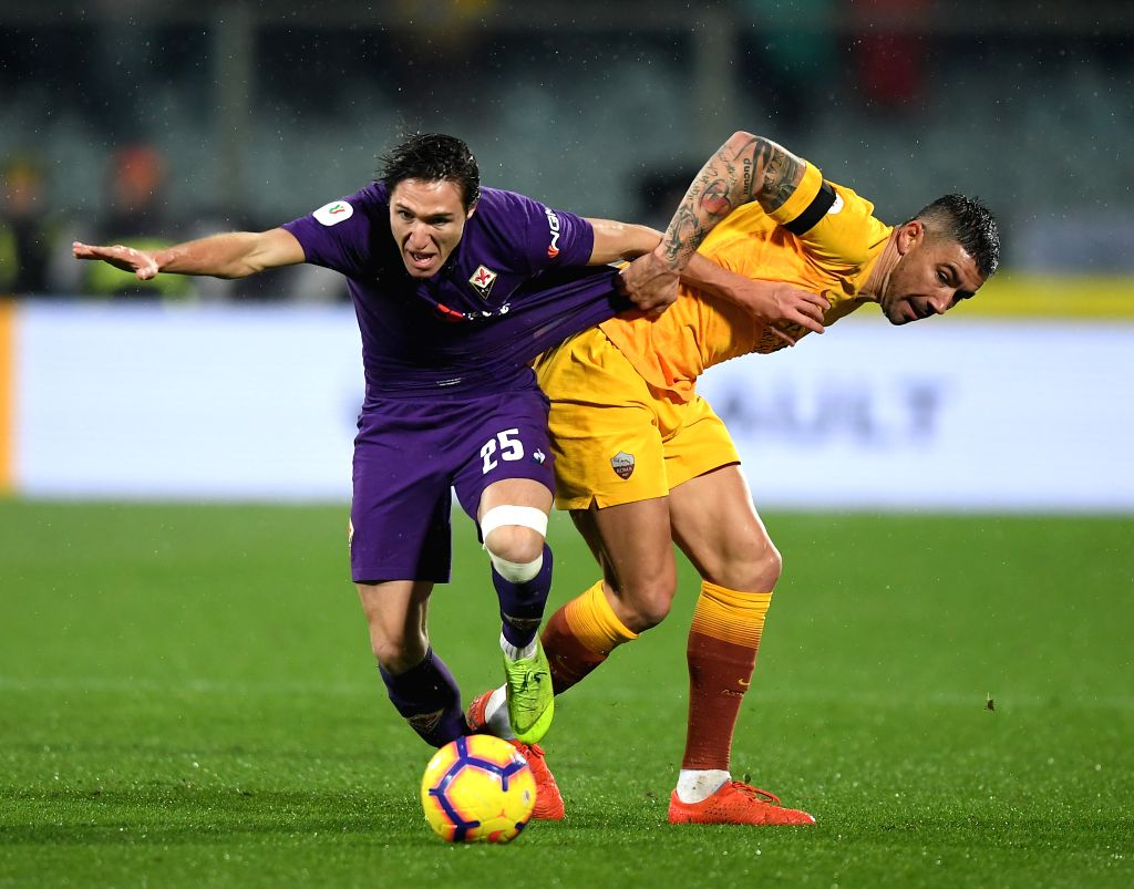 FLORENCE, Jan. 31, 2019 - Fiorentina's Federico Chiesa (L) vies with Roma's Aleksandar Kolarov during the Italian Cup quarterfinal soccer match in Florence, Italy, Jan. 30, 2019.
