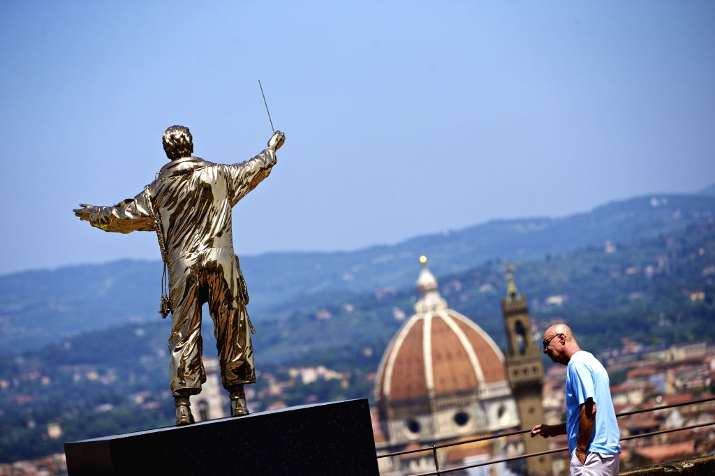"""FLORENCE, June 25, 2016 - A visitor looks at the exhibit """"The Man Who Conducts the Stars"""" at the Forte Belvedere in Florence, Italy, on June 24, 2016. Roughly one hundred of Belgian ... - Jan Fabr"""
