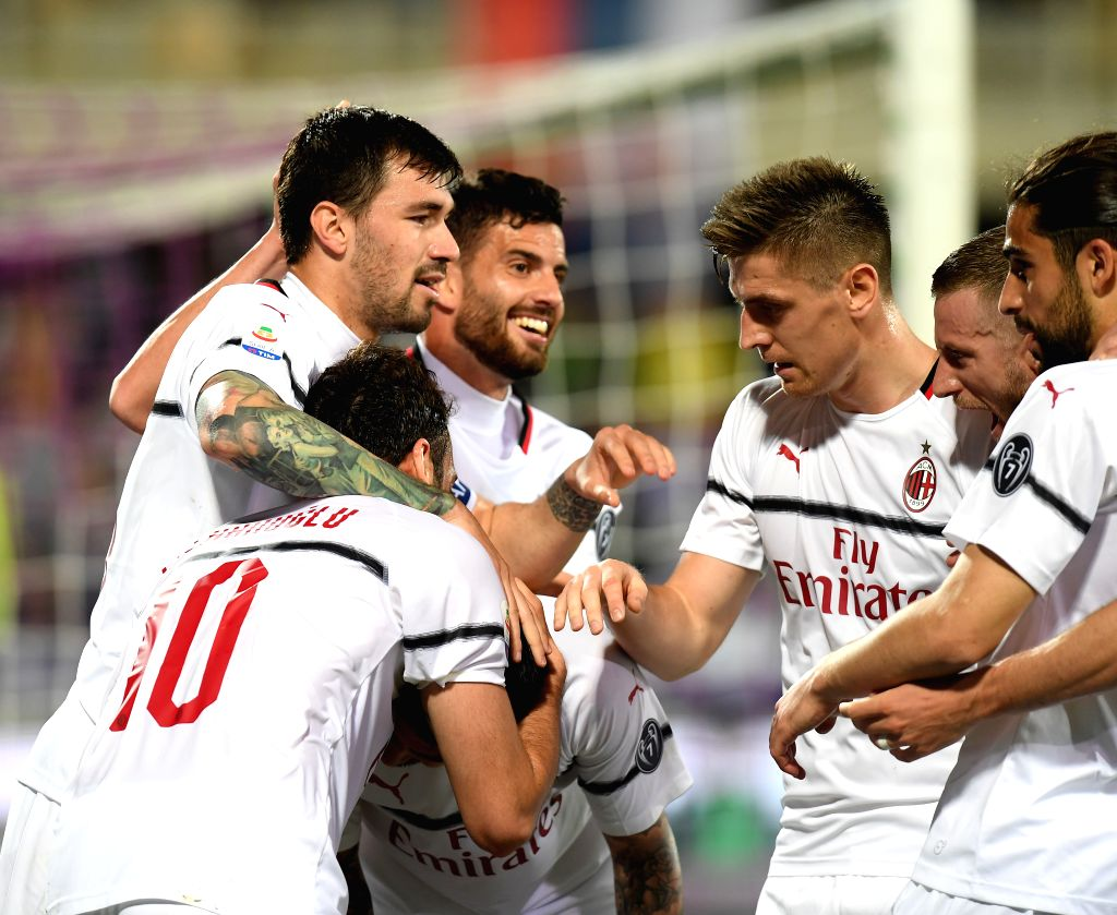 FLORENCE, May 12, 2019 - AC Milan's Hakan Calhanoglu (front L) celebrates scoring with his teammates during a Serie A soccer match between Fiorentina and AC Milan in Florence, Italy, May. 11, 2019. ...