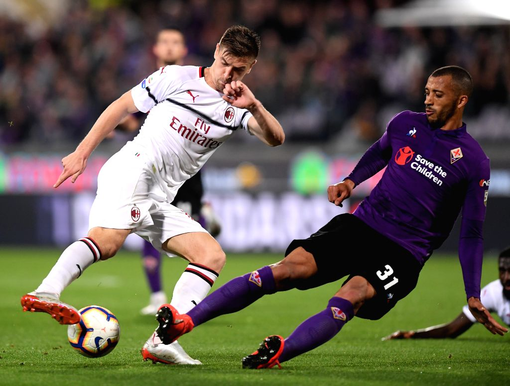 FLORENCE, May 12, 2019 - AC Milan's Krzysztof Piatek (L) vies with Fiorentina's Vitor Hugo during a Serie A soccer match between Fiorentina and AC Milan in Florence, Italy, May. 11, 2019. Fiorentina ...