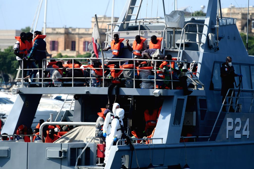 FLORIANA (MALTA), Aug. 26, 2019 Rescued migrants are seen on the Armed Forces of Malta's patrol boat P24 in Floriana, Malta, on Aug. 26, 2019. The Armed Forces of Malta brought in 73 ...