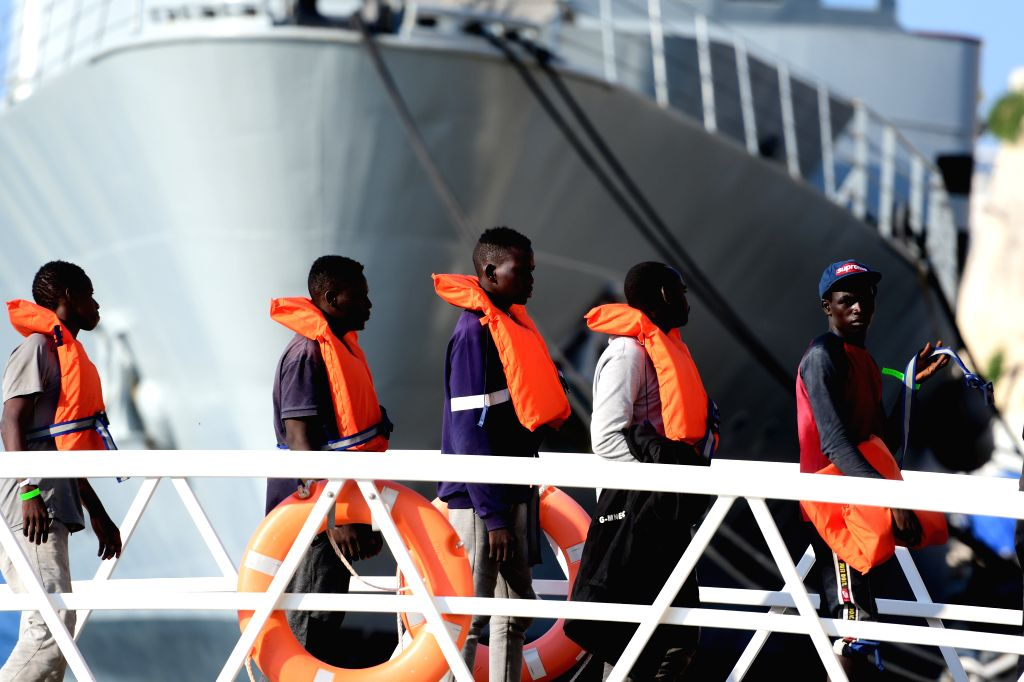 FLORIANA (MALTA), July 25, 2019 Migrants disembark at a naval base in Floriana, Malta, on July 25, 2019. A group of 76 migrants have been rescued by the Armed Forces of Malta and ...