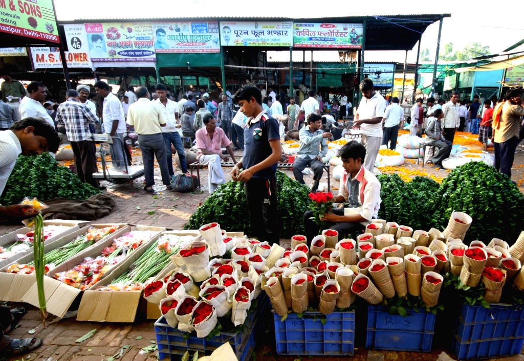 Florists busy working at Ghazipur wholesale flower market, in New Delhi on Sept 16, 2018.