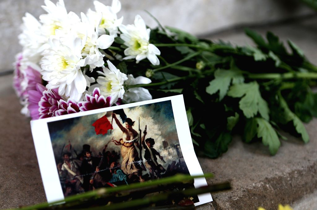 Flowers are placed in front of the French Embassy in London, Great Britain, to mourn the victims of a series of attacks in Paris, on Nov. 14, 2015. (Xinhua/Han ...