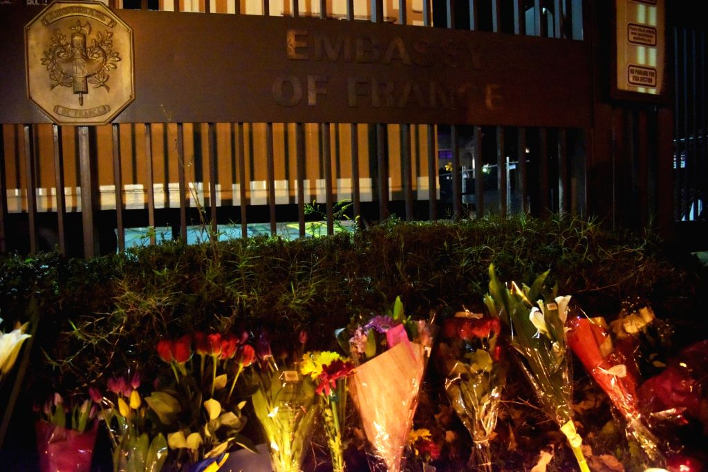 :Flowers are placed outside the French Embassy in Washington D.C., Nov. 13, 2015. Over 100 people were killed in a mass hostage-taking at a Paris concert hall ...