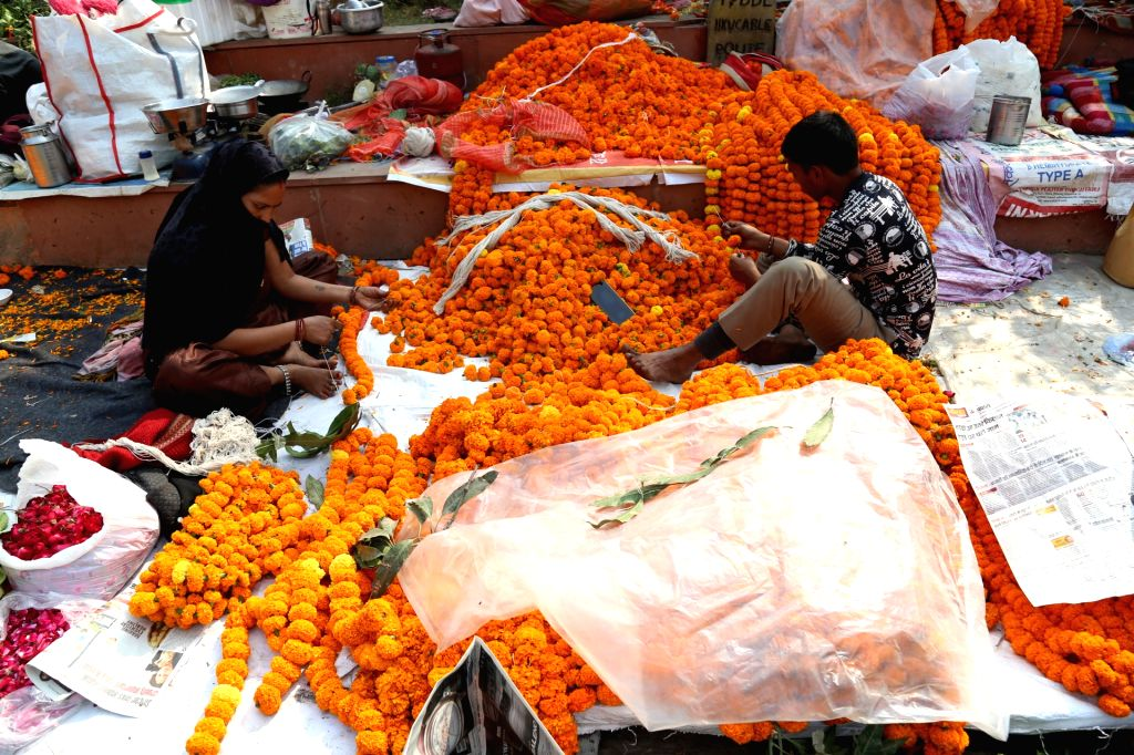 Flowers being sold at a flower market on the occasion of Diwali, in New Delhi on Nov 14, 2020.