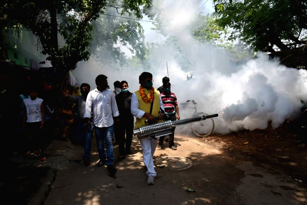 Fogging drive being conducted at a Patna slum to keep a check on the spread of COVID-19 during the extended nationwide lockdown imposed in the wake of coronavirus pandemic, on May 7, 2020.