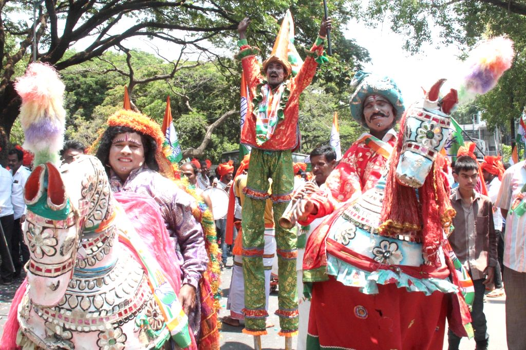 Folk artistes perform as Congress' Lok Sabha candidate from Bengaluru Central, Rizwan Harshad he heads to file his nomination papers for 2019 Lok Sabha elections in Bengaluru, on March 25, ...