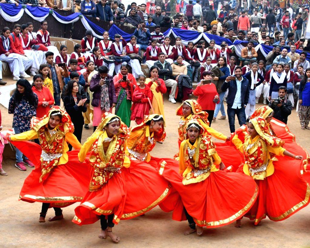 Folk artistes perform at the 33rd Surajkund International Crafts Mela, in Faridabad, on Feb 14, 2019.