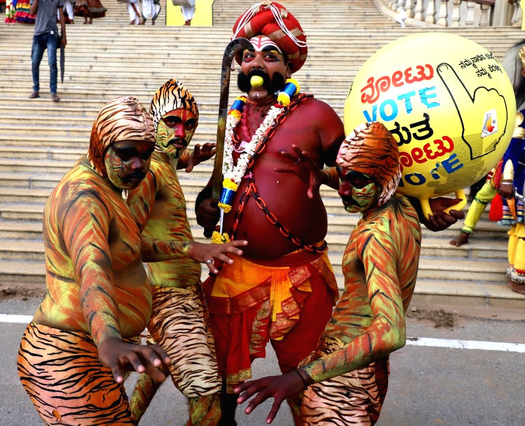 Folk artistes perform during shooting of a voters' awareness video in Bengaluru, on March 30, 2018.