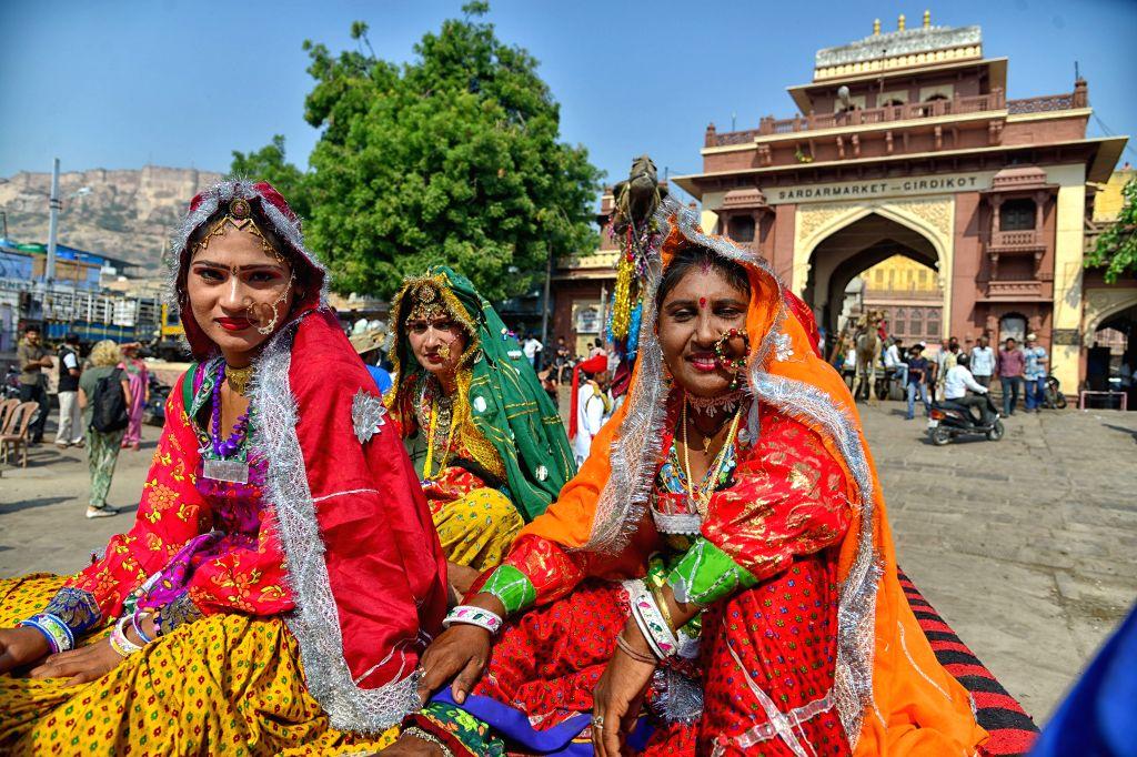 Folk artists pose for photograph during 'Marwar festival' at Sardar Market, Clock Tower in Jodhpur, Rajasthan, on Oct 26, 2015.