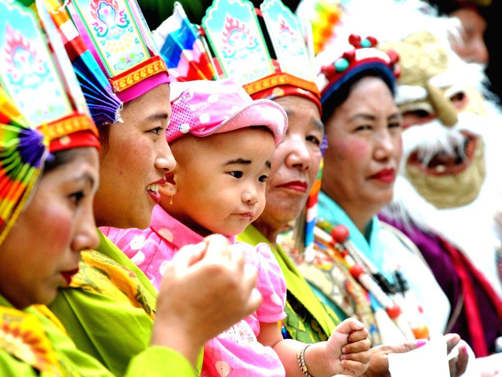 "Followers of Tibetan spiritual leader the Dalai Lama during ""Thank You Karnataka"" an event to mark 60th year of Tibetan arrival to India, in Bengaluru on Aug 10, 2018."