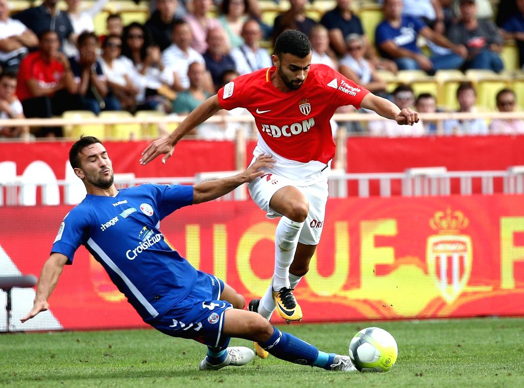 FONTVIEILLE, Sept. 17, 2017 - Rachid Guezzal (R) of Monaco competes with Pablo Martinez of Strasbourg during their match of French Ligue 1 in Fontvieille, Monaco on Sept. 16, 2017. Monaco won 3-0.