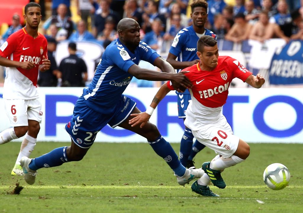 FONTVIEILLE, Sept. 17, 2017 - Rony Lopez (R) of Monaco competes with Ernest Seka of Strasbourg during their match of French Ligue 1 in Fontvieille, Monaco on Sept. 16, 2017. Monaco won 3-0.