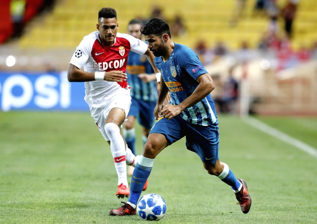 FONTVIEILLE, Sept. 19, 2018 - Jordi Mboula (L) of As Monaco vies with Diego Costa of Atletico Madrid during the UEFA Champions League group A match between As Monaco and Atletico Madrid in ...